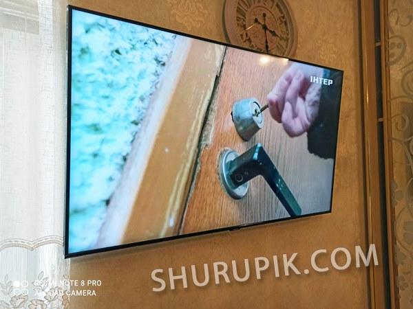 Крепление телевизора на кирпичную стену